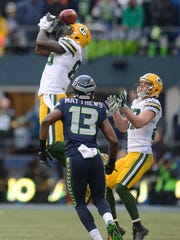 Green Bay Packers tight end Brandon Bostick can't catch an onside kick against the Seattle Seahawks during Sunday's NFC championship game at CenturyLink Field in Seattle. The Seahawks' Chris Matthews (13) recovered the ball.