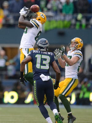 Green Bay Packers tight end Brandon Bostick can't bring in an onside kick against the Seattle Seahawks during the 20140 NFC Championship game at CenturyLink Field in Seattle. The Seahawks' Chris Matthews (13) recovered the ball.
