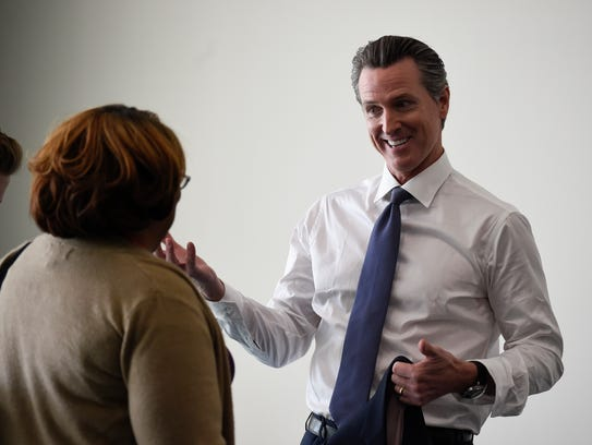 Gubernatorial candidate Gavin Newsom talks with a supporter