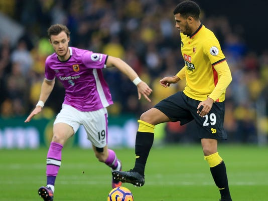 Hull City's Will Keane, left, battles for the ball with Watford's Etienne Capoue during their English League soccer match at Vicarage Road, Watford, England, Saturday, Oct. 29, 2016. (Nigel French/PA via AP)