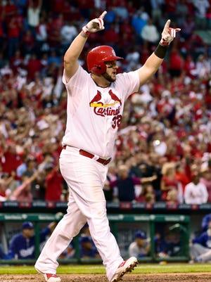 Matt Adams celebrates his three-run home run off Clayton Kershaw in the seventh inning.