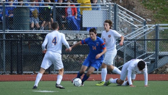 Seward's Jack Gardiner attempts to play the ball around