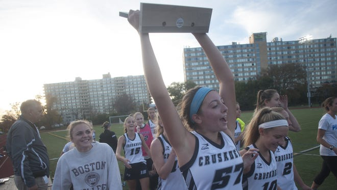Bishop Eustace Drew Pecora , raises the sectional championship trophy after the Crusaders defeatedr Paul VI in the Non-Public final.