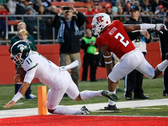 Connor Heyward, shown here scoring a touchdown against Rutgers last season, is averaging 4.6 yards per carry.