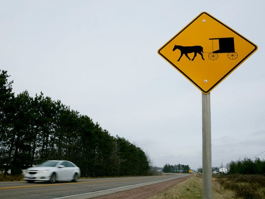 A horse and buggy warning sign is seen on Highway 186 in the town of Arpin.