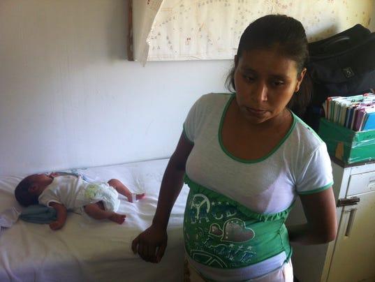 Woman denied help gives birth on a hospital lawn
