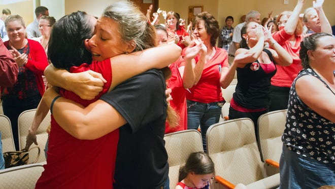 Rita Giddens, left, and Tess Brennan celebrate the Lee County School Board opting out of Common Core testing Wednesday (8/27/14) during a school board meeting in Fort Myers. Lee County is the first in Florida to opt out of Common Core.