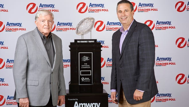 Grant Teaff, American Football Coaches Association (AFCA) Executive Director and Jim Ayres, Managing Director of Amway North America, unveil Amway's new landmark deal with USA TODAY Sports Media Group which includes first-ever entitlements the Amway Coaches Poll, formerly the USA TODAY Coaches Poll.  The sponsorship also includes the AFCA Coaches' Trophy presented by Amway, which will be awarded to the No. 1-ranked team, and national champion, in the Amway Coaches Poll following the conclusion of the college football season.