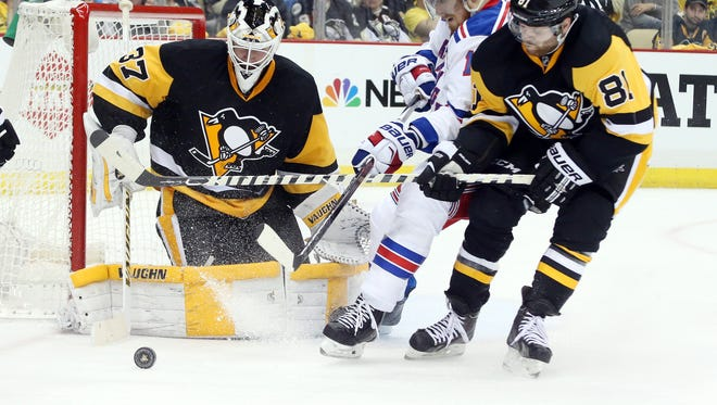Pittsburgh Penguins goalie Jeff Zatkoff (37) makes a save as Pens right wing Phil Kessel (81) defends New York Rangers defenseman Marc Staal (18) during the third period in game one of the first round of the 2016 Stanley Cup Playoffs at the CONSOL Energy Center.