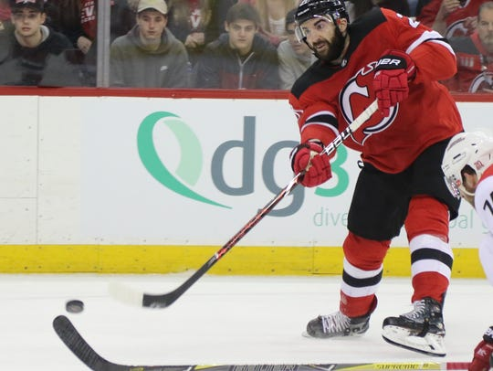Kyle Palmieri of the Devils takes a second period shot