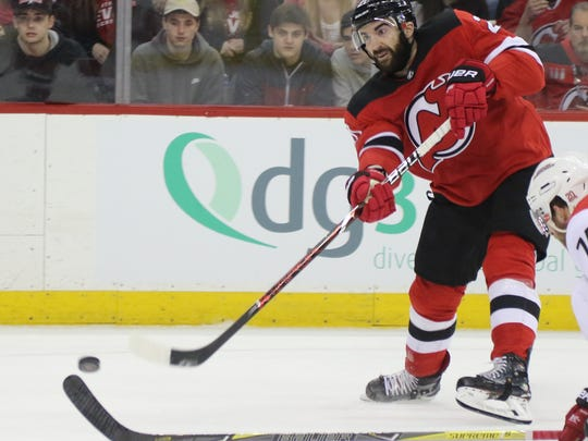 Kyle Palmieri of the Devils takes a second period shot on goal.