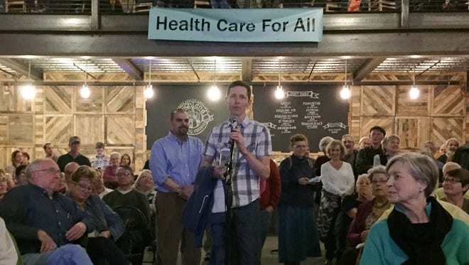 Swannanoa resident Christopher Fielden speaks at a town hall-style meeting on health care issues put on by local activists in Asheville in February.