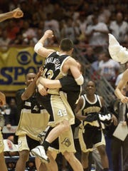 Carson Cunningham and his Purdue teammates celebrate defeating Oklahoma  66-62 in the second round of the Western Regional at Tucson, Arizona. The Boilermakers reached the Elite Eight before losing to Wisconsin 64-60.
