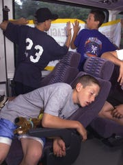 Todd Frazier catches a nap on the bus as R.J. Johansen