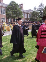 Rowan University benefactor Henry Rowan walks with the procession after the 2000 graduation commencement in Glassboro. Rowan delivered the commencement address to the class of 2000, which included the first-ever School of Engineering graduating class, a school Rowan's large monetary gift created.