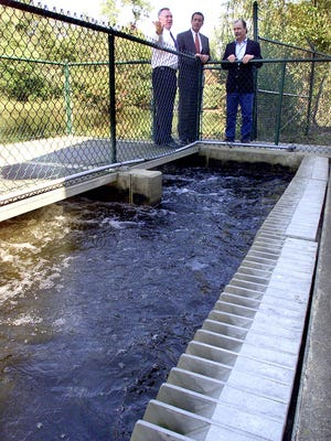 Brick Municipal Utilities staff stand near an intake off the Metedeconk River in this 2001 photograph.