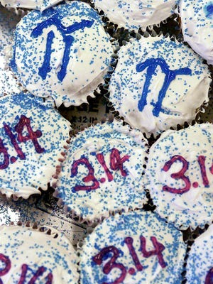 In this file photo, cupcakes are decorated for Pi day.