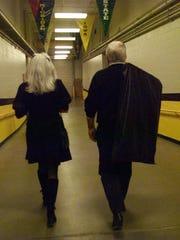 Former Iowa Coach Tom Davis and his wife, Shari, walk down Carver-Hawkeye Arena tunnel toward basketball floor prior to game vs. Ohio State in 1999.  -Caption: Iowa Coach Tom Davis, right, and his wife Shari make their familiar walk through Carver-Hawkeye Arena. Ran B&Wh