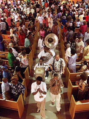 The procession to Bunk Johnson's grave begins in St. Edward's Catholic Church where the jazz legend was a member of the New Iberia church.