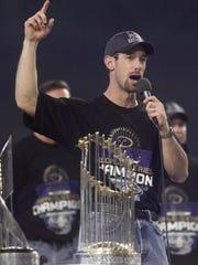 Luis Gonzalez celebrates the Diamondbacks' World Series title.