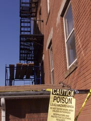 The Assembly Housing and Community Development Committee is holding public hearings around the state to hear concerns about environmental health hazards affecting the state's rental properties. A sign warns of lead paint hazards in a 2002 file photo from Perth Amboy.