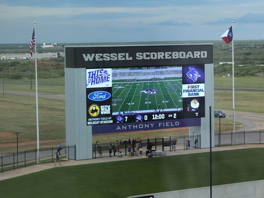 Looking north toward the huge scoreboard from the working press area of Wildcat Stadium.