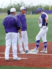 Wylie head coach Clay Martin, middle, and assistant grant Martin check on center fielder Sam King (33) after he hit first base awkwardly during a 2018 game against Brownwood. When Clay Martin was named the new head football coach and athletic director on Jan. 31, 2020, Grant Martin was named the new head baseball coach. The baseball season was put on hold on March 12 due to the coronavirus pandemic.