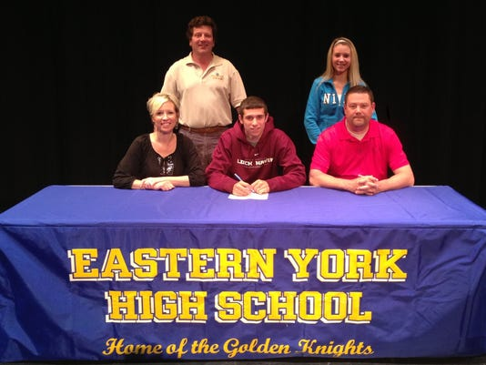Eastern York senior Dalton Reichard recently signed his letter of intent to play Division II college basketball for Lock Haven. Seated from left, mother Treva Reichard, Dalton Reichard and father/coach Jon Reichard. Standing from left, athletic director Jack Predix and sister Hannah Reichard. (SUBMITTED)