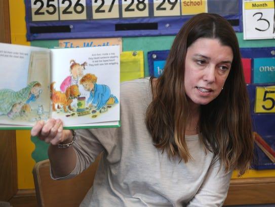 First-grader teacher Rebecca Moore, reads to her class