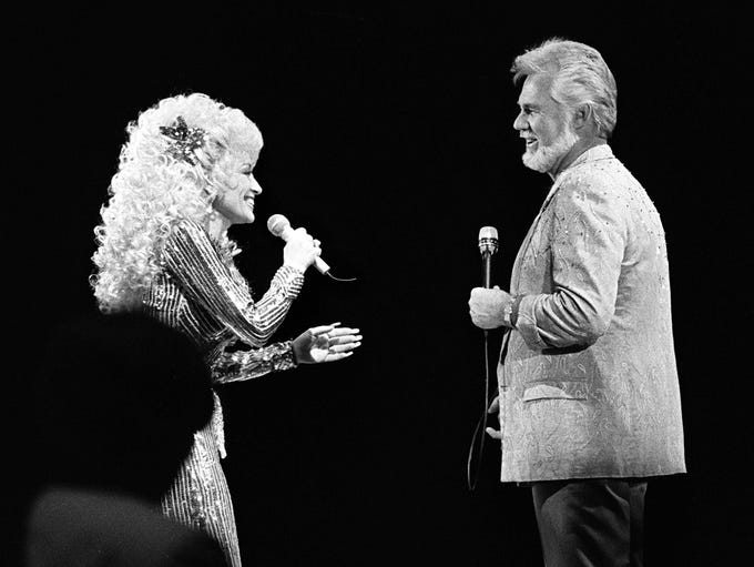 Dolly Parton, left, and Kenny Rogers perform together