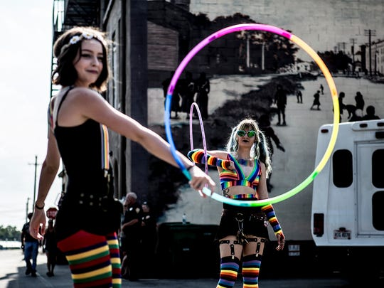 Sasha Savranska and Bre Kay show off their hula hoops moves during the first ever Pride event in Newark.  Hundreds of people turned out for Newark's Pride event. The celebration, which took place at the Canal Market District included musical acts, booths set up selling memorabilia and face painting.