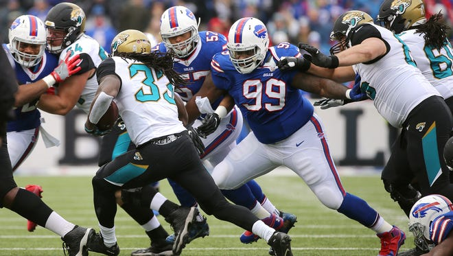 Bills Marcell Dareus fights off a blocker to get Jaguars running back Chris Ivory.