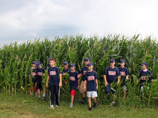 The Central Iowa team, who were the 10/11-year-old Iowa District 3 Little League Champions of 2011, exit the Field of Dreams.