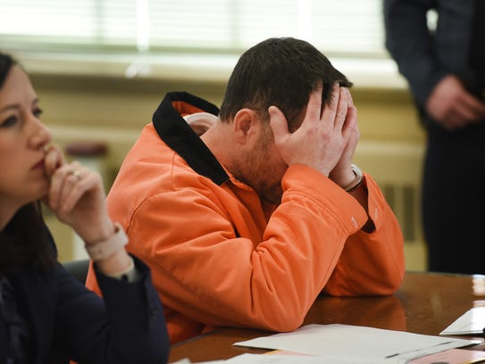 Richard Spielman, 45, of Kinnelon, reacts as he sits next to his lawyer Liz Cervenak during his detention hearing on Thursday, March 15, 2018.