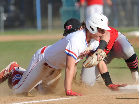 Abilene Cooper's Braiden Hill slides safely into third