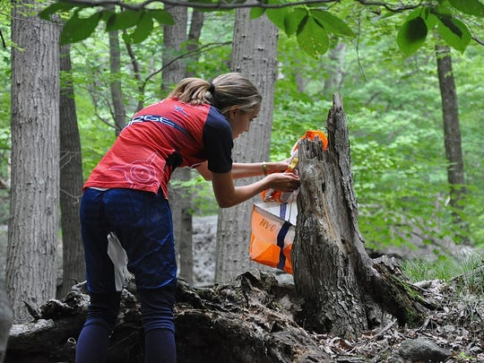 Orienteering involves running or walking in the woods and using only a map and compass to guide you to control locations on a map.