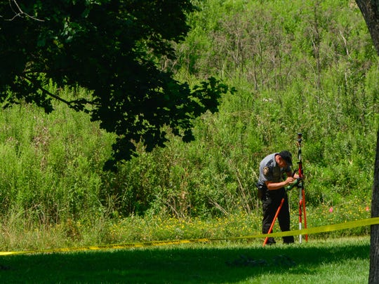 PA State Police investigate the scene of a reported body found in a grassy area off of Seaks Run Rd., Friday, August 12, 2016. John A. Pavoncello photo