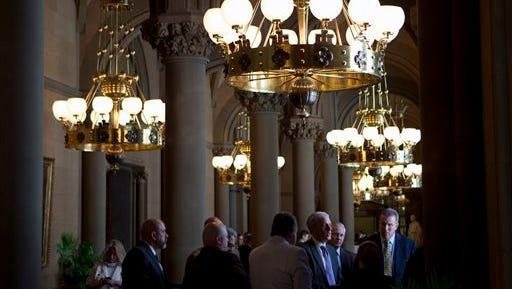 People work in the Senate lobby at the state Capitol on Wednesday, June 15, 2016, in Albany, N.Y. The Legislature is scheduled to adjourn its session this week.