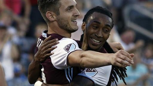 Colorado Rapids forward Kevin Doyle, left, hugs midfielder Marlon Hairston after scoring a goal against the Chicago Fire in the second half of an MLS soccer match Saturday, June 18, 2016, in Commerce City, Colo.