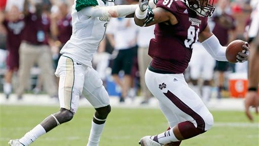 UAB wide receiver Jamarcus Nelson (1) tries to tackle Mississippi State defensive lineman Preston Smith (91) after he intercepted a pass in the first half of an NCAA college football game in Starkville, Miss., Saturday, Sept. 6, 2014. Smith ran the ball into the end zone for a touchdown. (AP Photo/Rogelio V. Solis)
