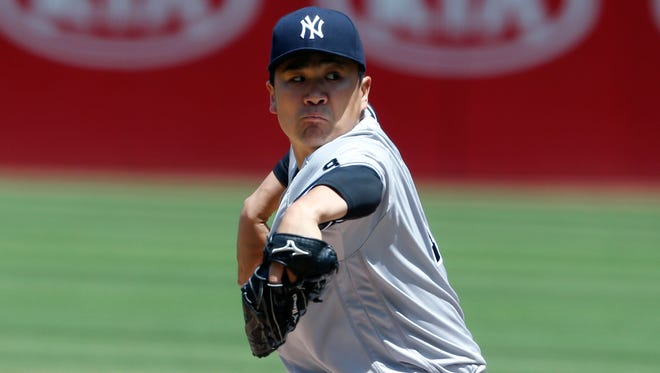 New York Yankees starting pitcher Masahiro Tanaka delivers against the Cleveland Indians during the first inning of a baseball game Sunday, July 10, 2016, in Cleveland.