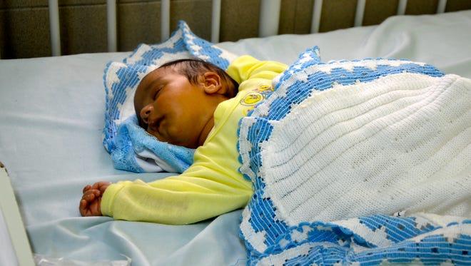 Abdel Rahman Bakr rests at Al-Makassed hospital in east Jerusalem on July 25.