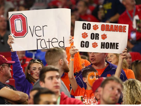 Clemson fans hold up signs as Clemson plays Ohio State