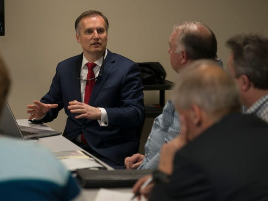 CEO Dr. John Bender speaks at a meeting on Wednesday,