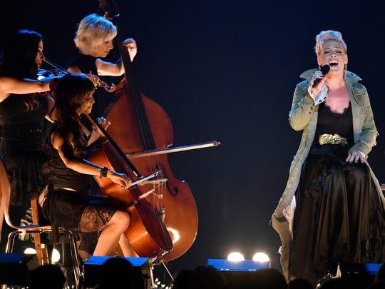 Pink performs during the CMA Awards Wednesday, Nov. 8, 2017 at Bridgestone Arena in Nashville, Tenn.