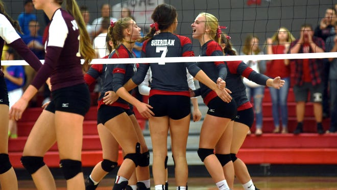 Sheridan players celebrate after winning a point in the second set against visiting John Glenn on Tuesday at Glen Hursey Gymnasium. The Generals lead the Muskingum Valley League by two games.