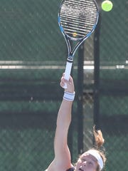 Daphne Visscher hits a shot against Maty Cancini of Iowa State Friday.