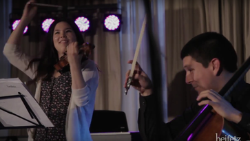 Violinist Rachell Wong and cellist Nicholas Mariscal playing a collection of Celtic fiddle tunes at one of last summer's Heifetz Hootenannies at the Stonewall Jackson Hotel. Wong, from Lynwood, WA, claims half-Chinese, half-Scottish ancestry, and will be among the alumni artists returning to the Heifetz Institute in 2016.