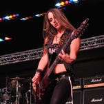 Nikki Stringfield, guitarist with the all female band Femme Fatale, who performed on Sunday evening at 80's in the Park 2016, a three day rock and roll concert event held at the Melbourne Auditorium, presented by Platt Hopwood Attorneys at Law.