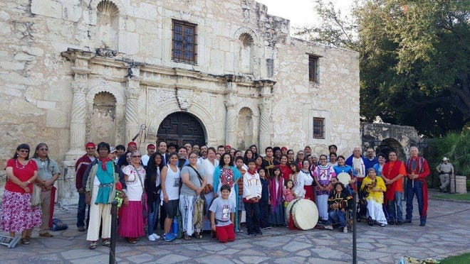 Members of the Tap Pilam Coahuiltecan Nation gather outside the Alamo in 2018.